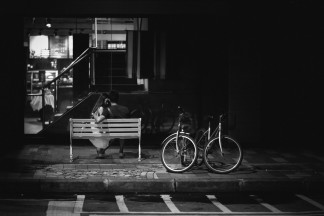 There is tension in this image on many levels. View the two bikes, the couple, the balance and positioning of both the bench and the bikes. The contrast of the right side of the frame compared to the left also creates tension. The positioning of the couple and their body language is more tension.