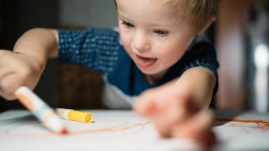 Photo of the Day: Little Boy Happily Drawing