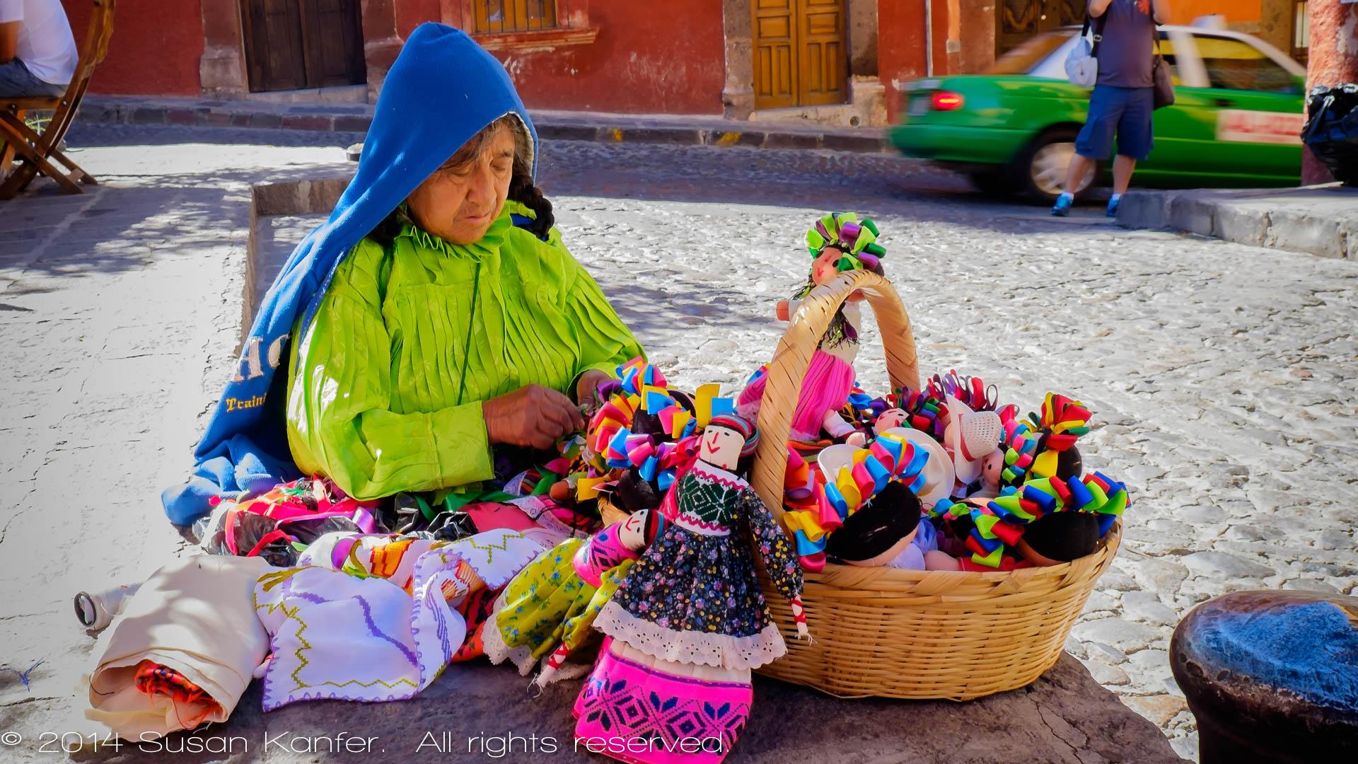 Woman Making Dolls
