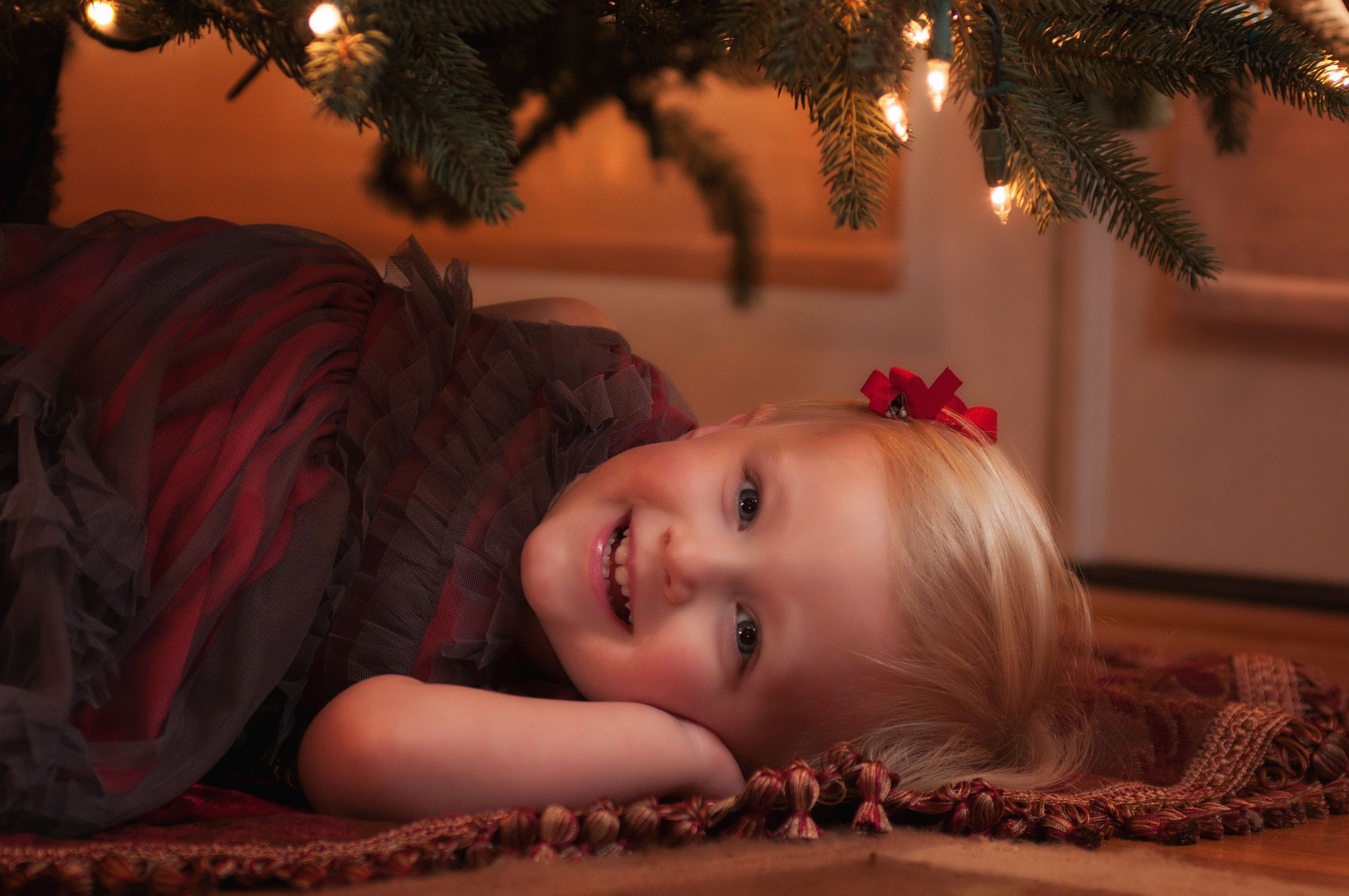 a-child-plays-under-the-christmas-tree