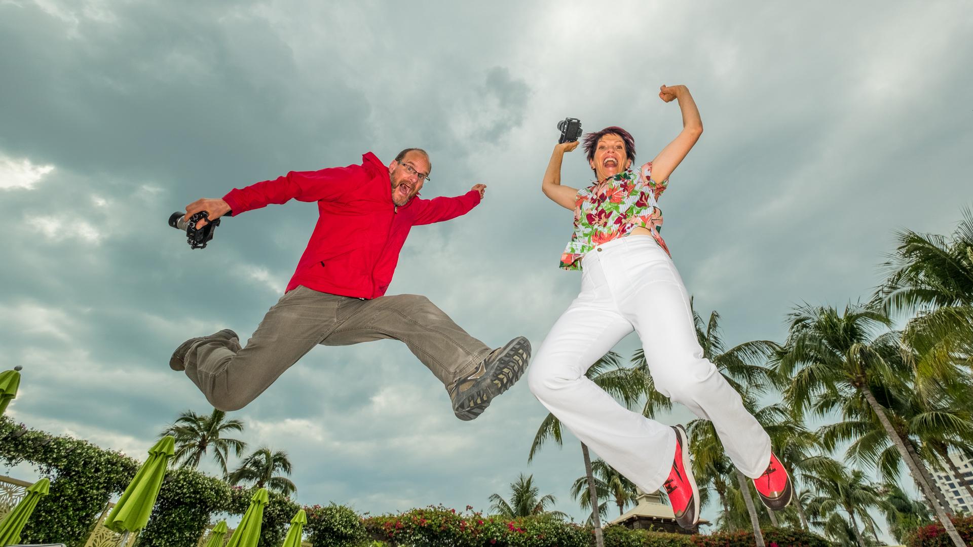 Dan Bailey and Karen Hutton, Fujifilm X Team Photographers, jumping for joy in Florida
