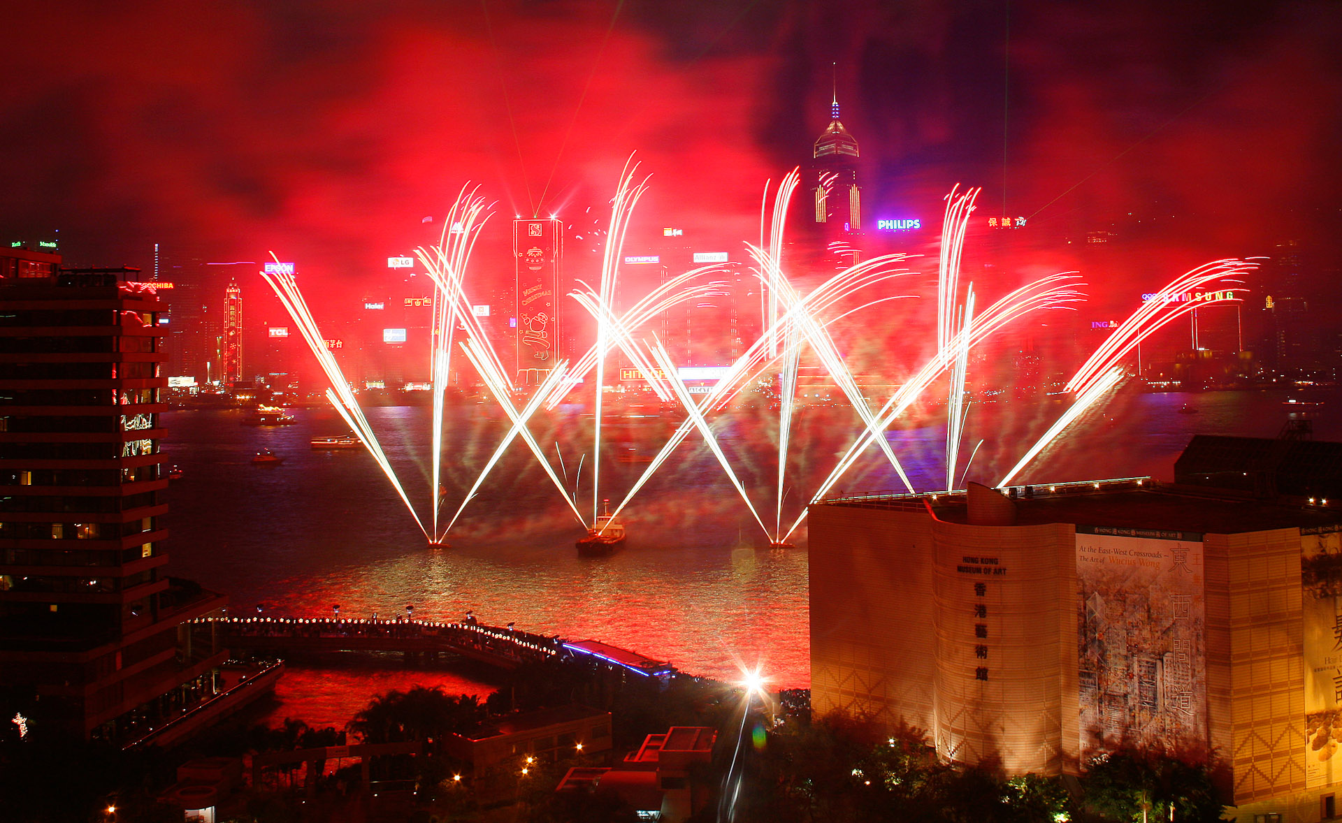 Fireworks over Hong Kong on January 1, 2007 to celebrate New Years day. In the foreground is the Hong Kong Museum of Art. The photograph was shot from the Kowloon.