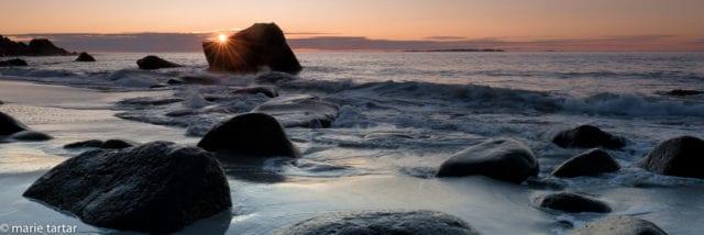 Boulder beach at sunset in Lofoten, Norway