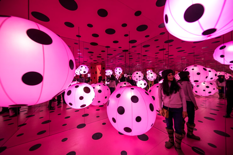 Pink balloons and black polka dots are one of the rooms in Yayoi Kusama's Infinity Mirrors exhibition. ©2019 Kevin Ames