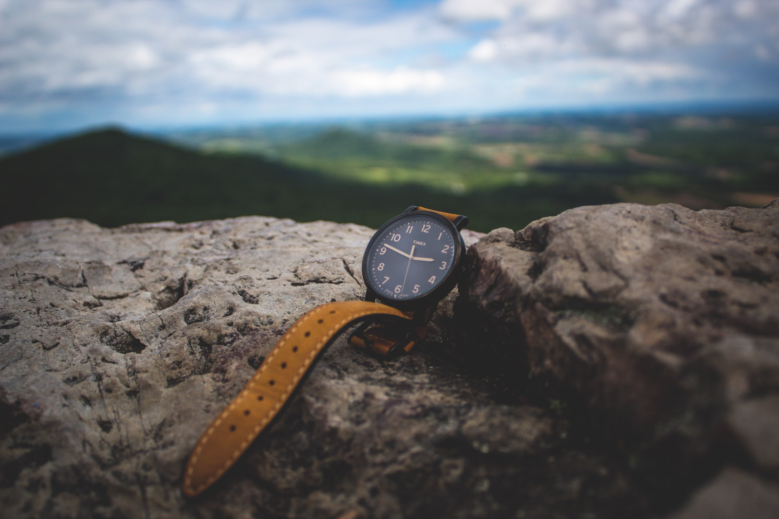 A watch on the mountain overlooking a landscape.