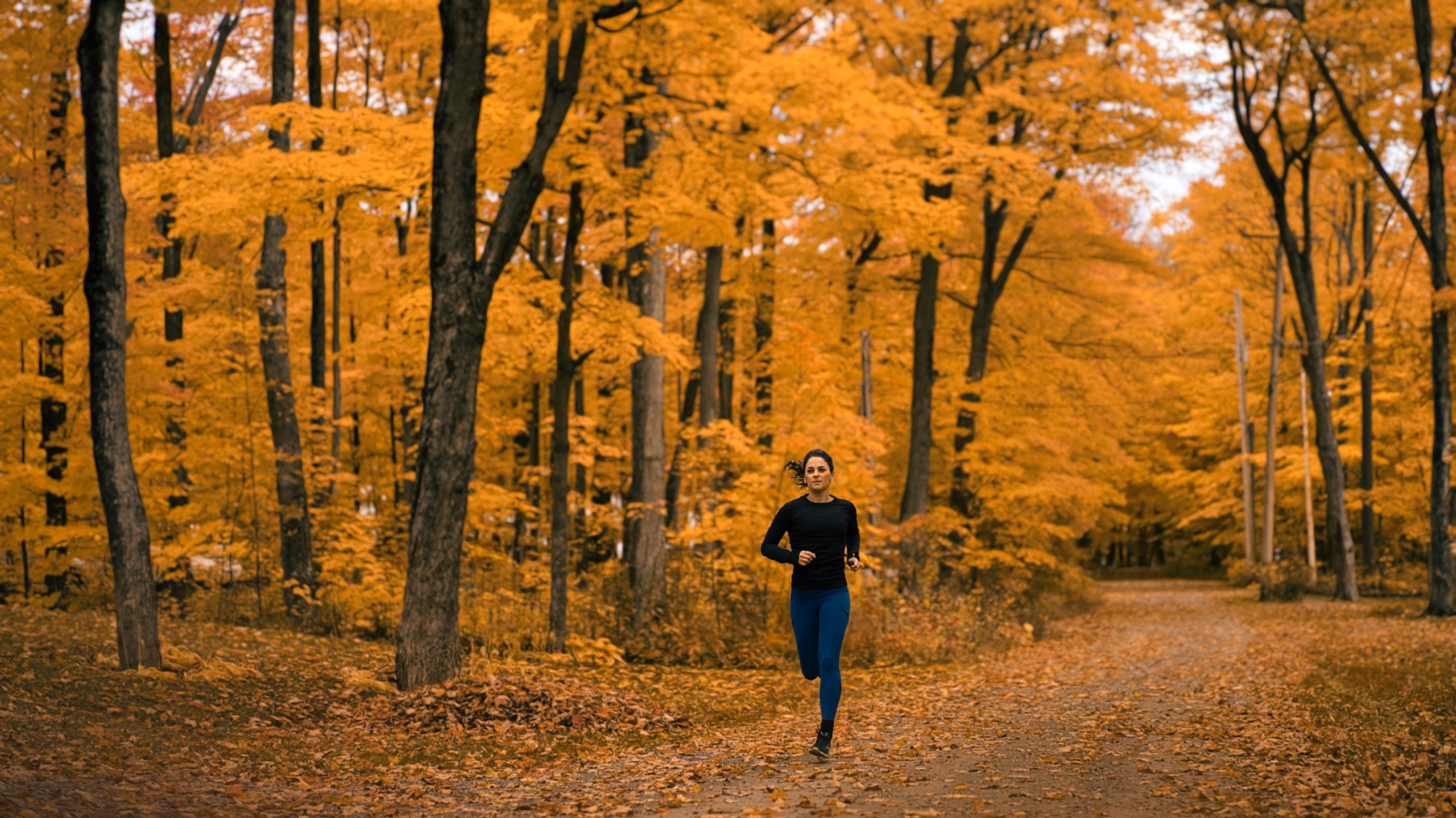 Female runner fall forest